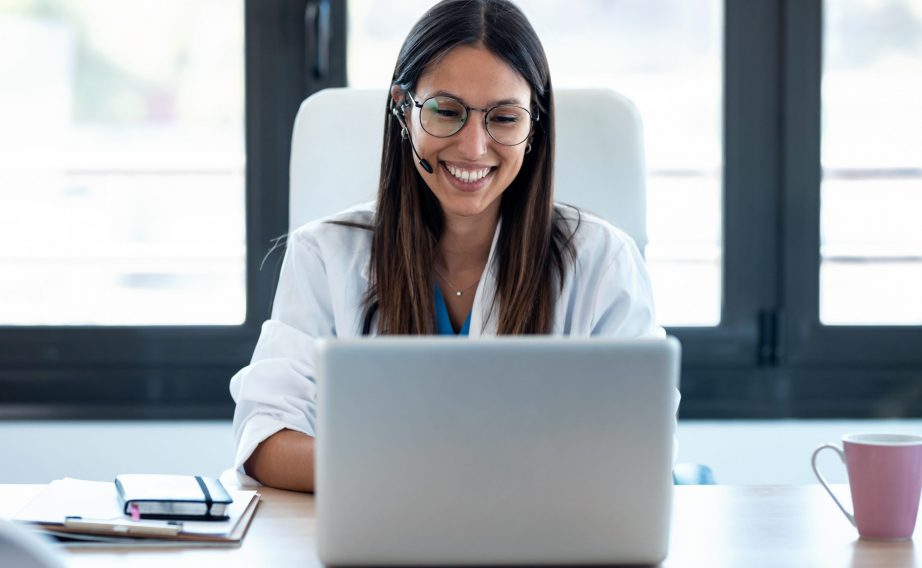 smiling doctor on computer