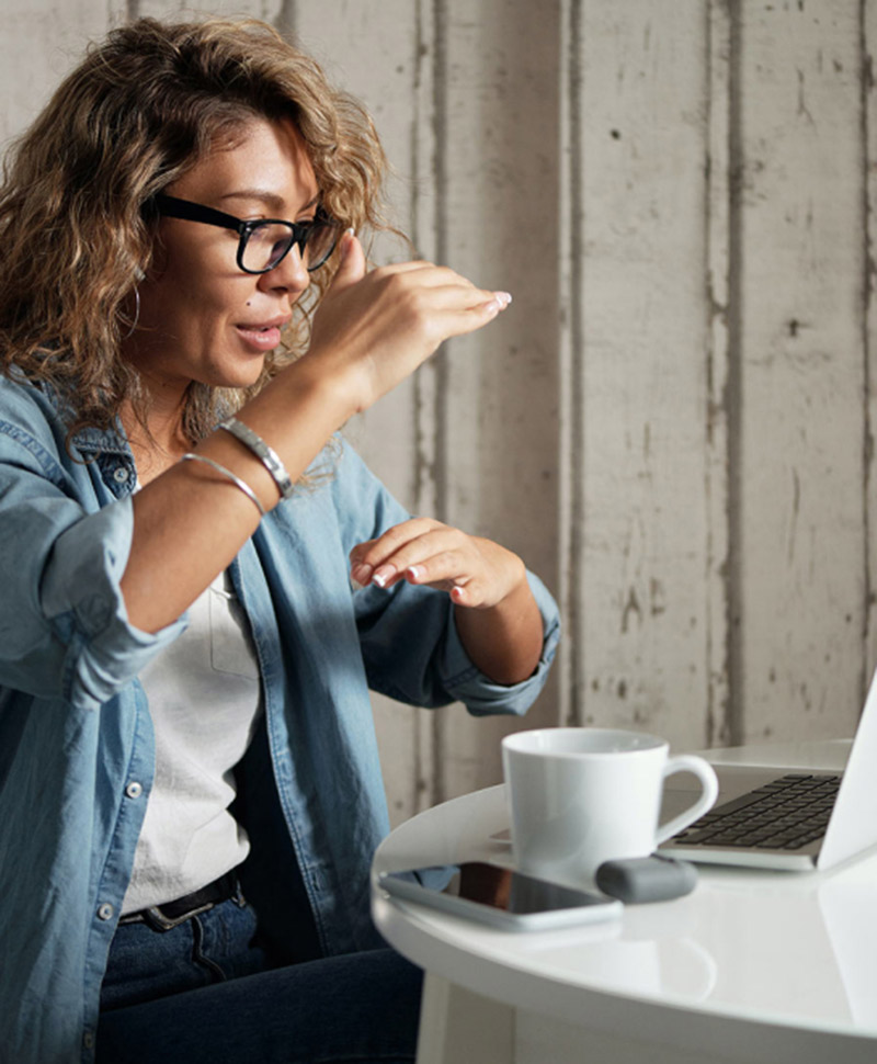 woman on computer gesturing with hands